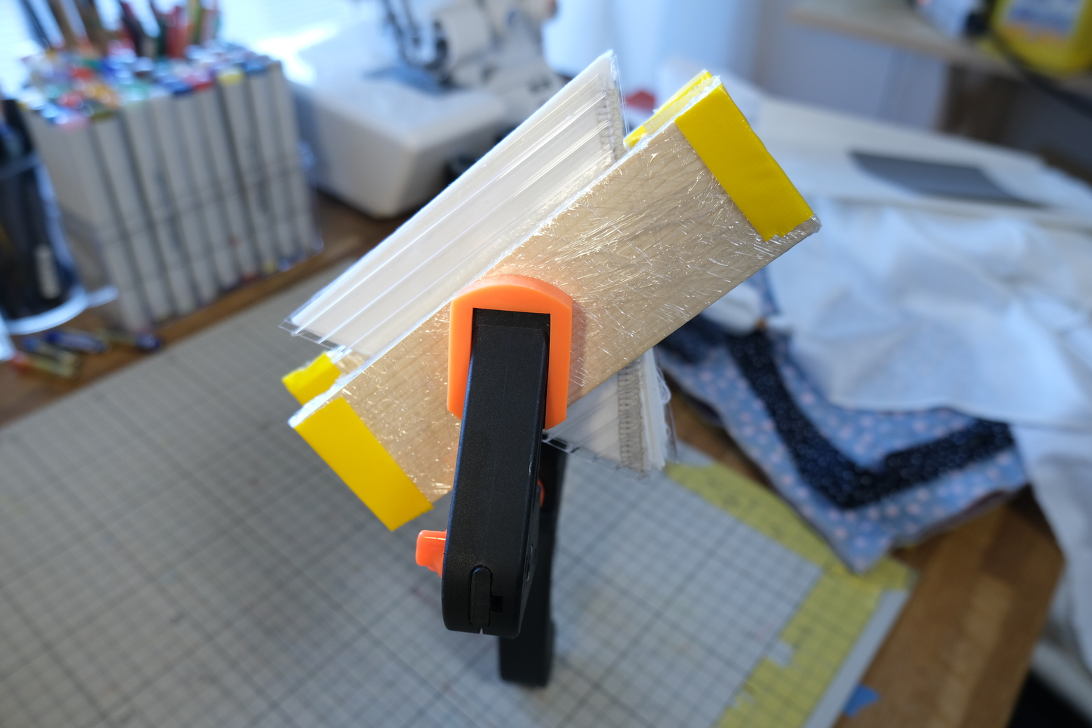 fabric clamped between pieces of wood